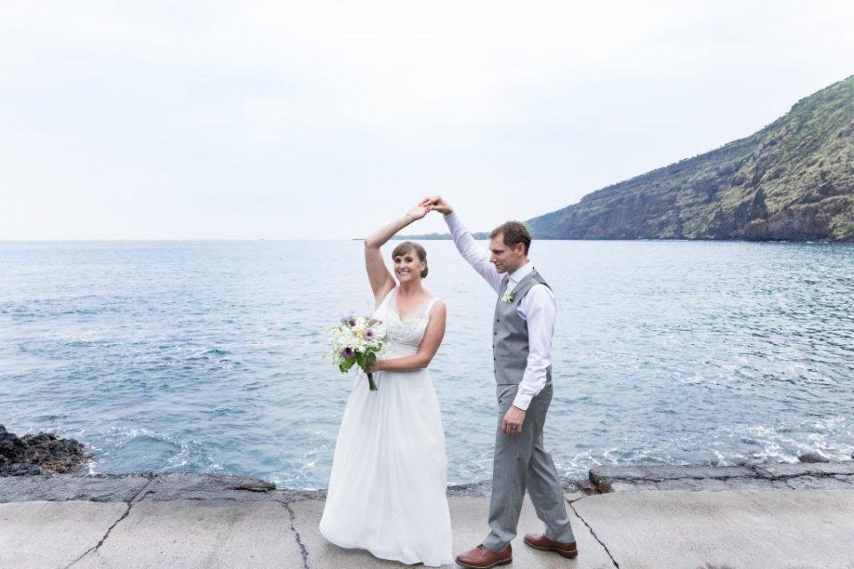 couple dance in front of the ocean Kealakekua Bay Wedding Venue