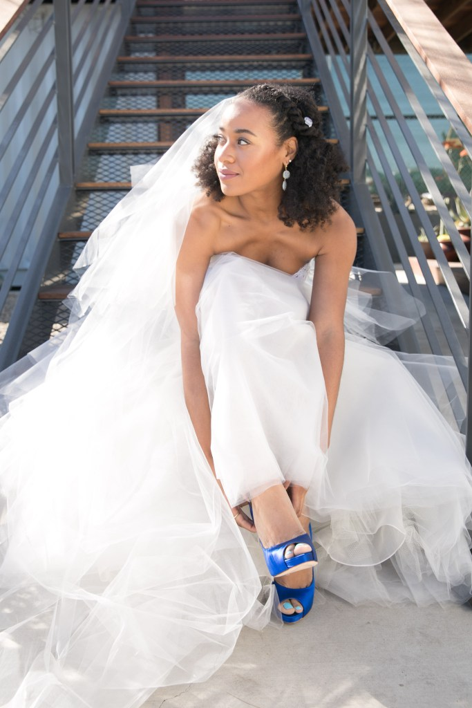 bride wears blue shoes