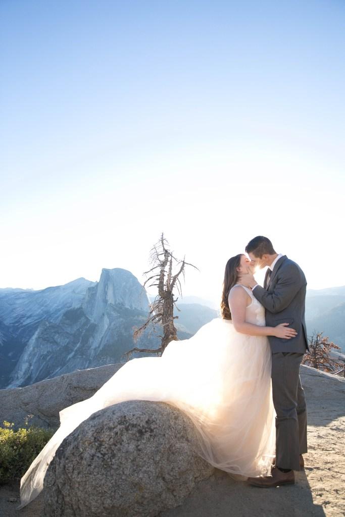 couple kiss over yosemite view