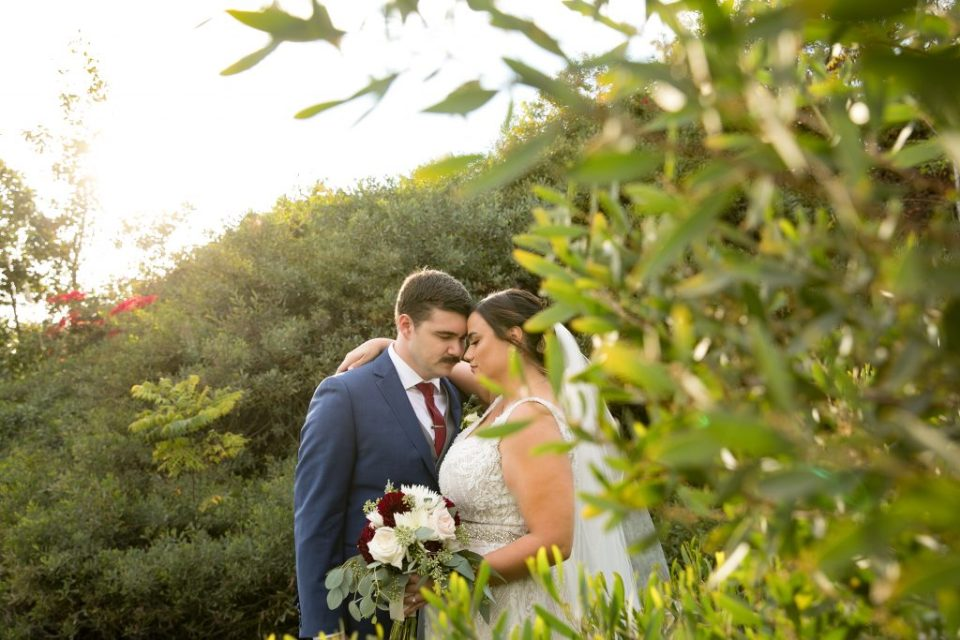bride and groom embrace after wedding ceremony
