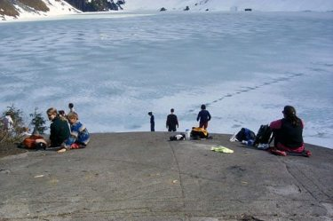 Picnic boulder at frozen Lake Serene