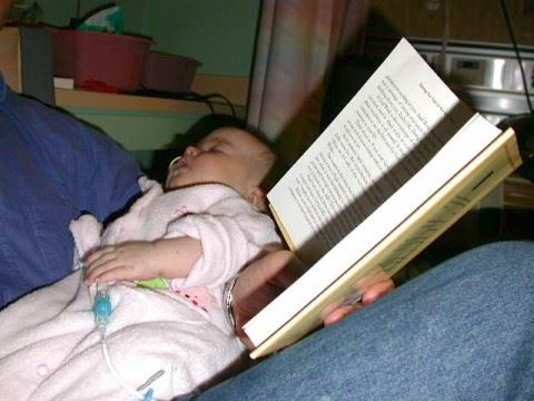Steven Pecevich (father) reading to baby Sydni