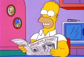 Homer reading newspaper