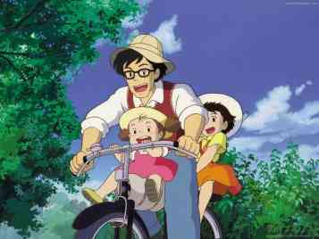 A father rides with his young daughters in My Neighbour Totoro