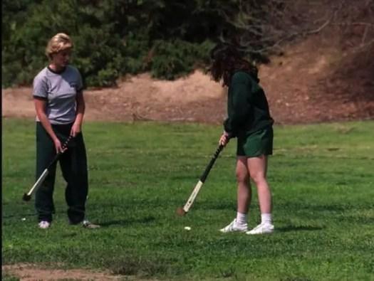 girls play hockey