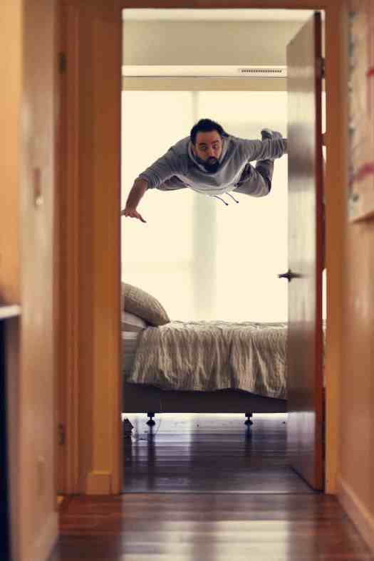 man flies above his bed