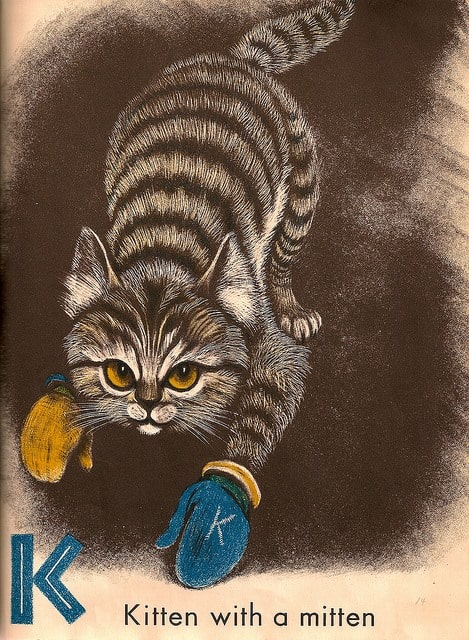 Fritz Eichenberg, 1952 kitten with a mitten. Looks more like a boxing glove to me.