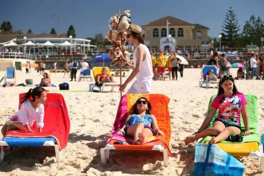 Modern Family girls sunbathing at Bondi Beach