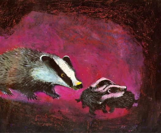 badgers underground. A mother badger with two babies