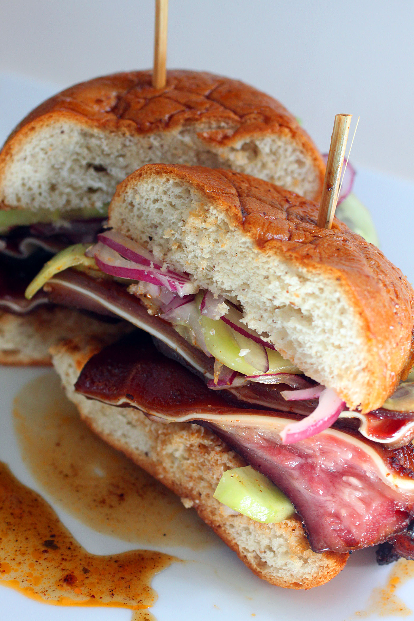 Barbeque Pig Ear Sandwich With Pink Cucumber Onion Relish