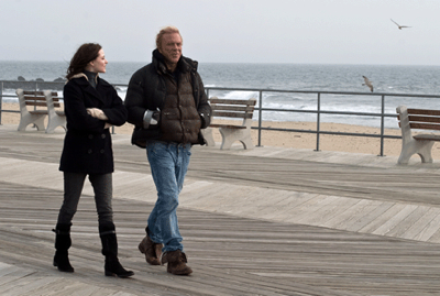Evan Rachel Wood and Mickey Rourke walk along the lonely Jersey Shore on a cold winter's day in THE WRESTLER.