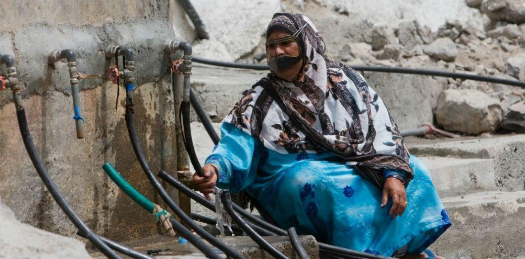 Station d'approvisionnement en eau dans un village non loin de Khasab (Sultanat d'Oman), dans le détroit d'Ormuz, face à l'Iran, le 1er mai 2008 | REUTERS/Ahmed Jadallah