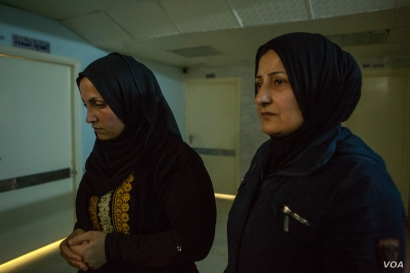 Sarah-8: Sara's mother, Nariman, weeps as she explains that her four children were injured in a bombing last week, one died and