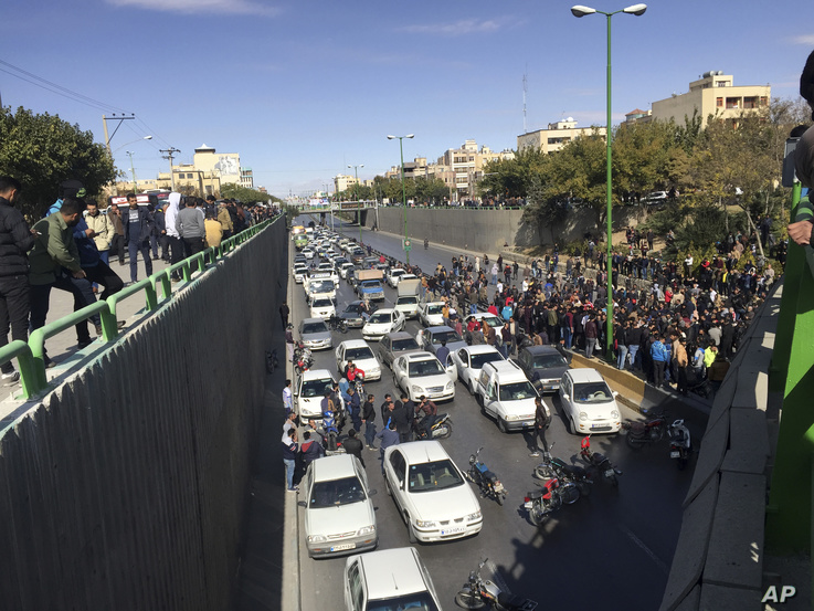 Cars block a street during a protest against a rise in gasoline prices, in the central city of Isfahan, Iran, Nov. 16, 2019.