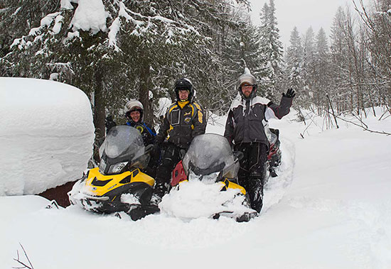 Russian snowmobilers Igor Zapivalov, Roman Shtefan, Evgeniy Borodin