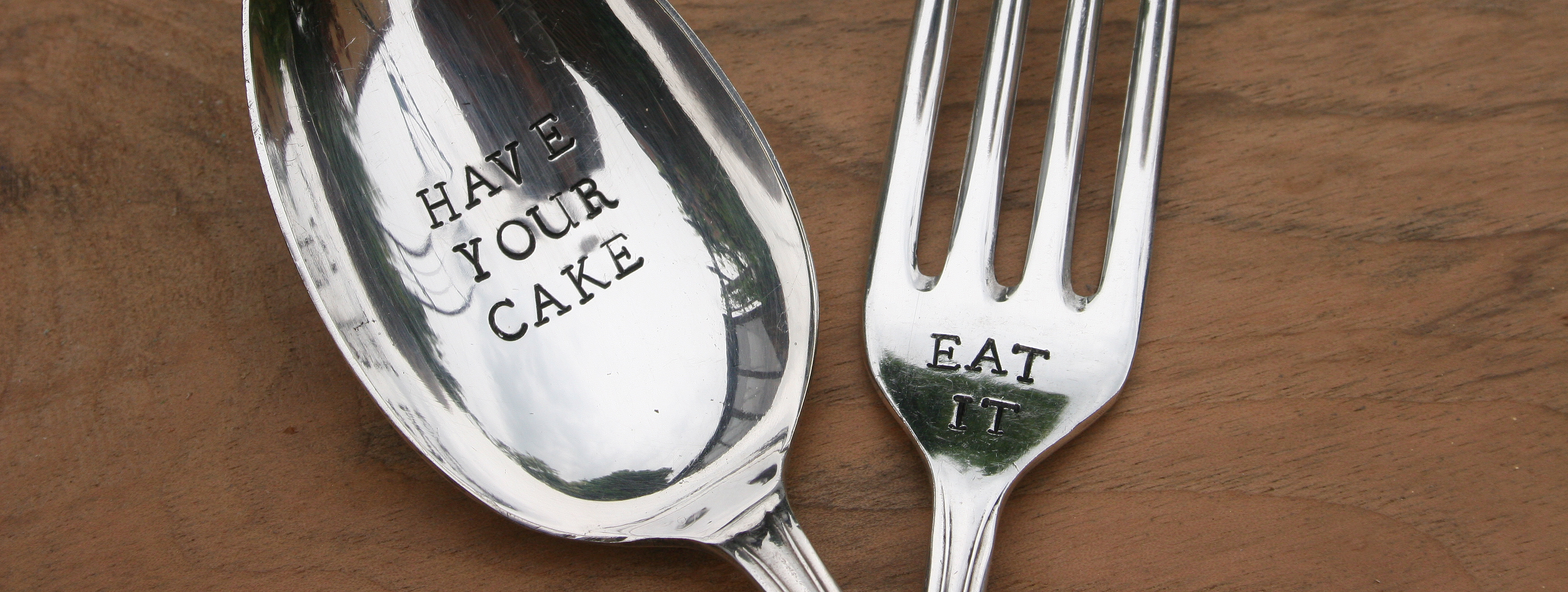 Have your cake and eat it stamped on spoon and fork