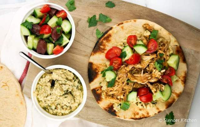 Weight Watchers Chicken Shawarma on a wooden cutting board with hummus.