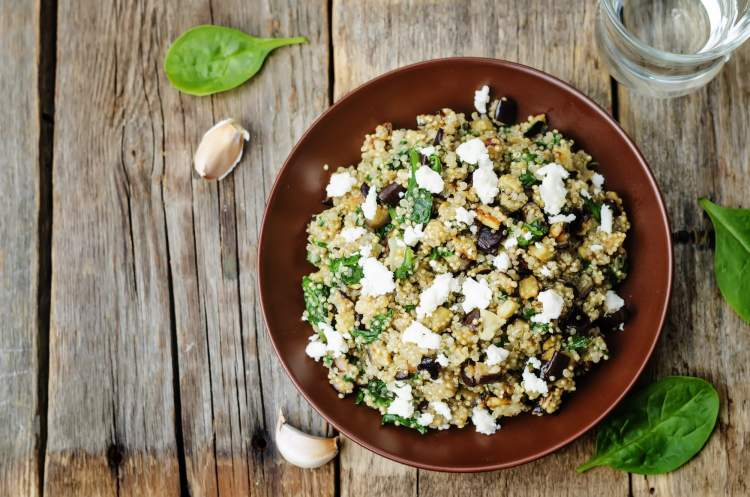 Weight Watchers Roasted Eggplant and Quinoa Salad with Feta on a wooden board.