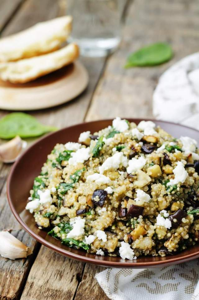 Vegetarian Roasted Eggplant and Quinoa Salad with Feta in a wooden bowl.