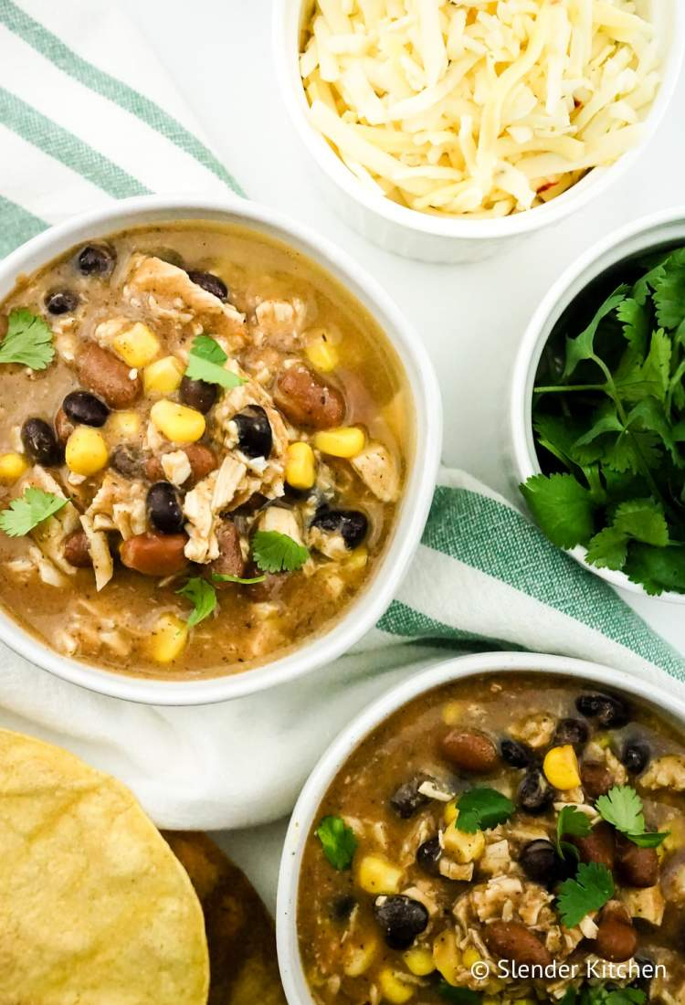 Weight Watchers Taco Soup on a white napkin with cheese and cilantro.