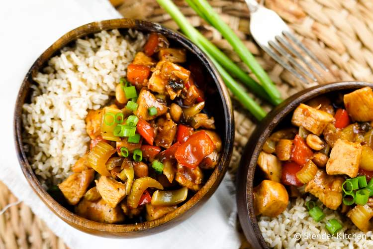 Healthy Kung Pao Chicken in a wooden bowl.