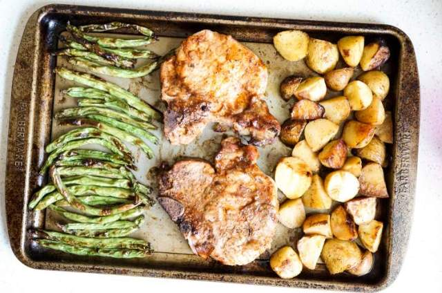 Sheet Pan Pork Chopswith roasted green beans and potatoes.