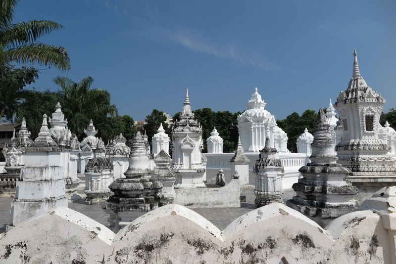 white masoleums at Wat Suan Dok