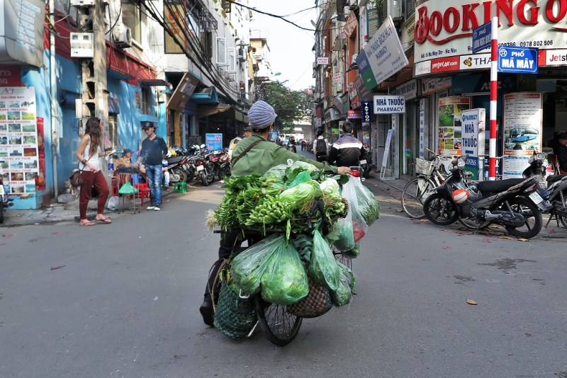 bike vendors are a common sight. this one is laden with fresh veggies