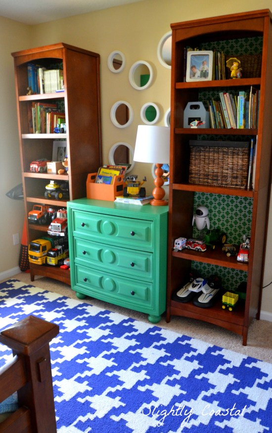 Dresser flanked by bookcases, hounds tooth rug