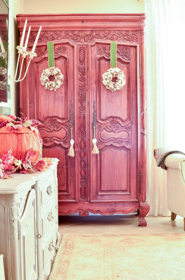 French Furniture Armoire with Cotton Wreathes hung on the doors with ribbons