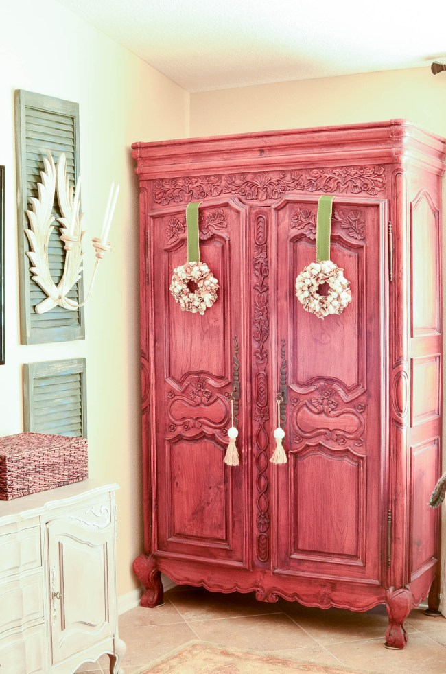 A French Armoire with Cotton Wreaths on the Doors is such a sweet fall touch.