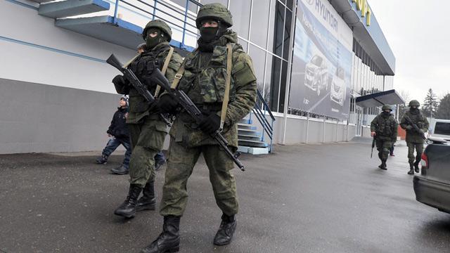 Armed men patrol outside Simferopol airport