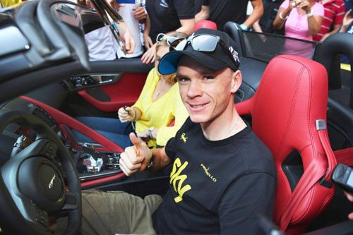Chris Froome relaxes in his new Jaguar after winning the Tour de France