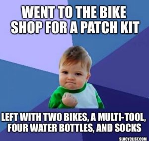 Went to the bike shop for a patch kit. Left with two bikes, a multi-tool, four water bottles, and socks.