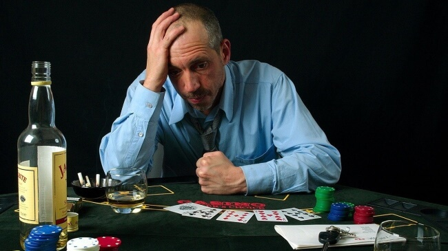 What are the complications and negative effects of gambling addiction