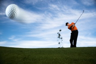 golfer-driving-ball-in-motion