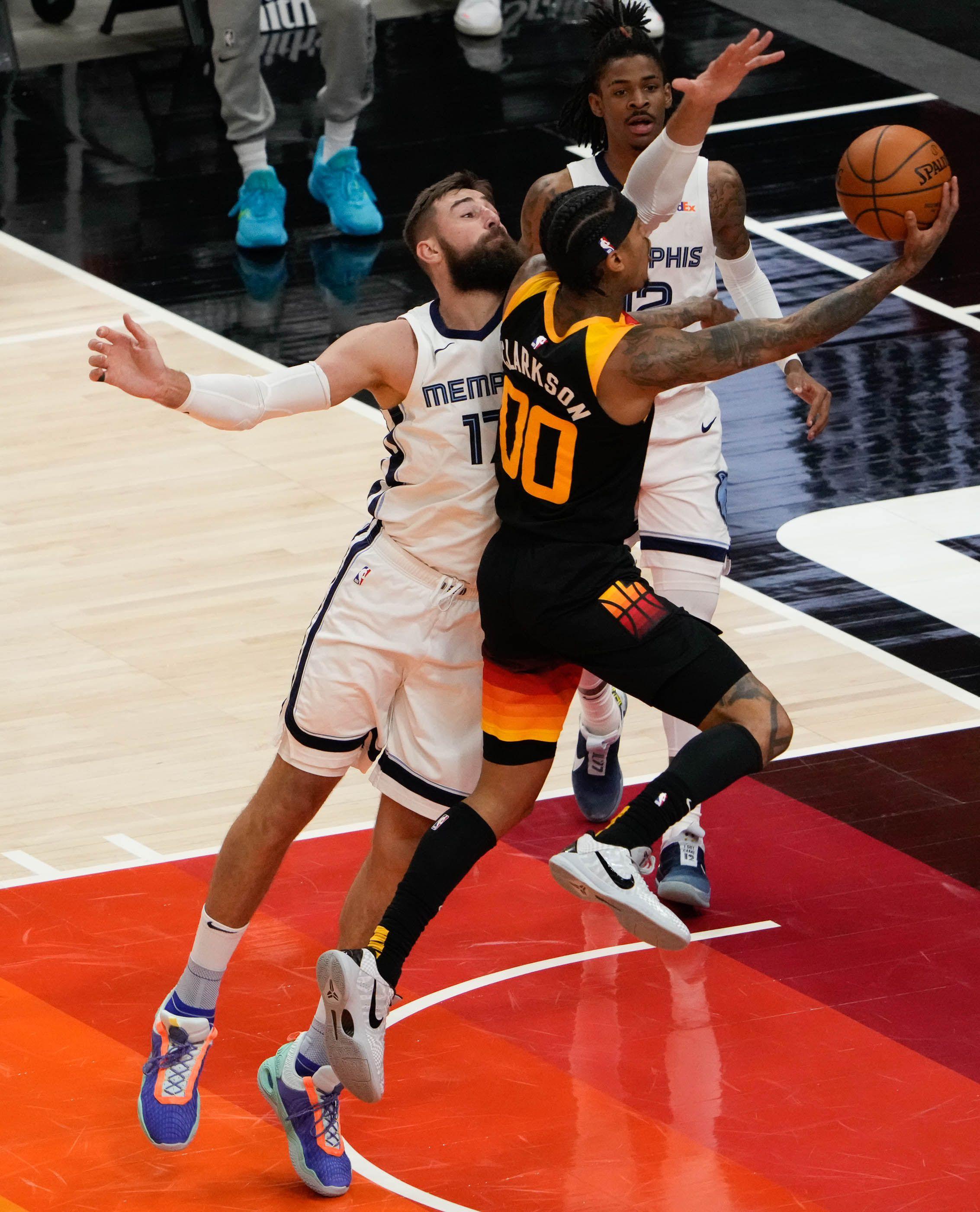 (Francisco Kjolseth | The Salt Lake Tribune) Utah Jazz guard Jordan Clarkson (00) lays one up past Memphis Grizzlies center Jonas Valanciunas (17) in the first half of Game 5 of an NBA basketball first-round playoff series Wednesday, June 2, 2021, in Salt Lake City, UT.