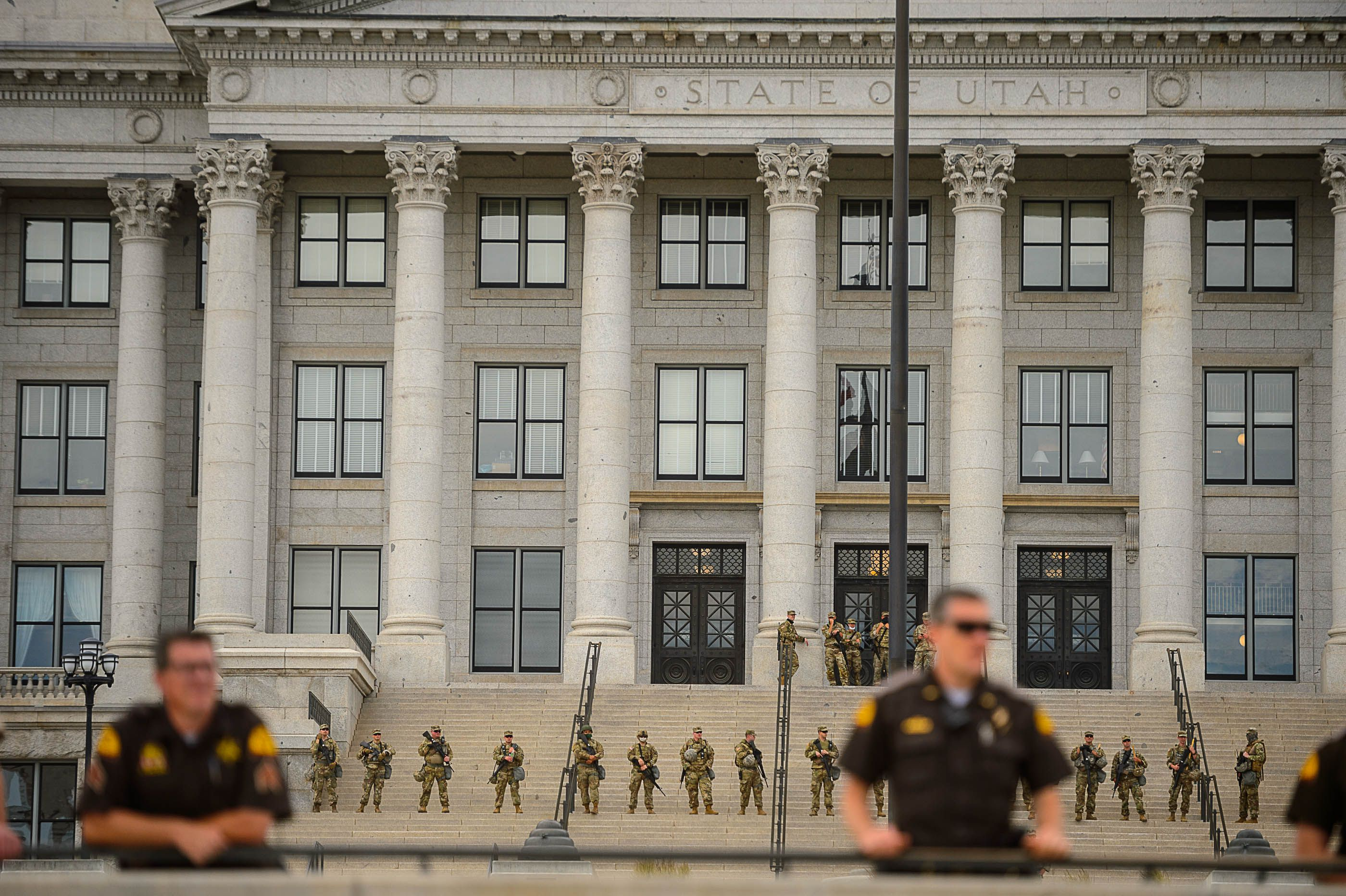 (Trent Nelson  |  The Salt Lake Tribune) Police stand by as protesters rally against police brutality in Salt Lake City on Thursday, June 4, 2020.