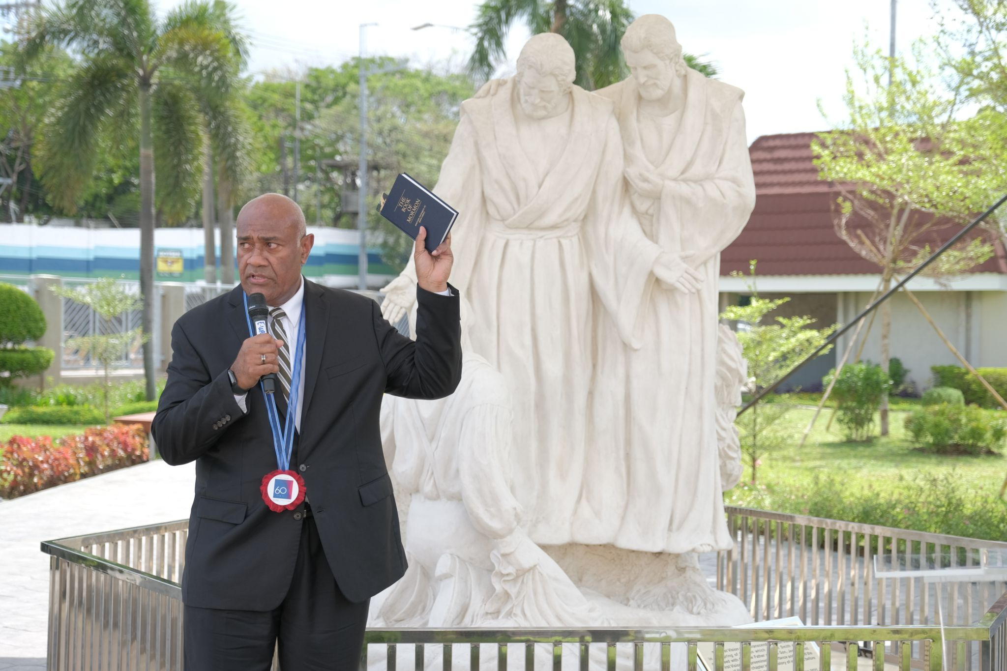 """(The Church of Jesus Christ of Latter-day Saints) Elder Taniela Wakolo of the Philippines Area Presidency speaks at the unveiling of a statue of the """"First Vision"""" outside the Missionary Training Center in the country."""