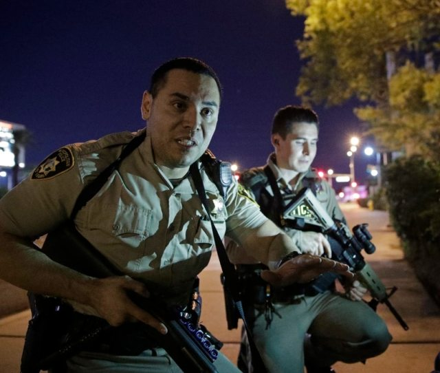 Police Officers Advise People To Take Cover Near The Scene Of A Shooting Near The Mandalay