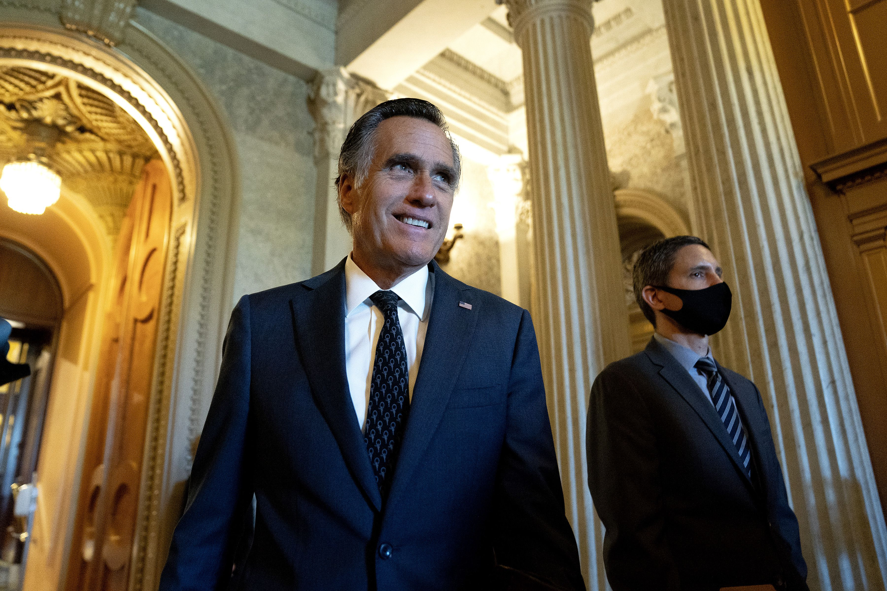 (Stefani Reynolds | The New York Times) Sen. Mitt Romney, R-Utah, departs the Senate Chamber at the Capitol in Washington on Wednesday, May 19, 2021. Romney was awarded the Profile in Courage Award from the Kennedy Family Foundation.