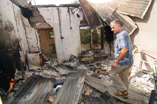 Fr Dan surveys the destruction of the Priest's House