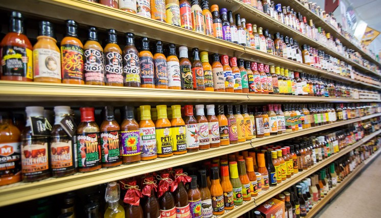 An Aisle of hot-sauces at Double DD Meats