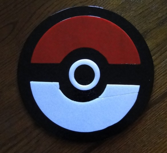 A a tack fused glass Pokeball, about 8 inches across.