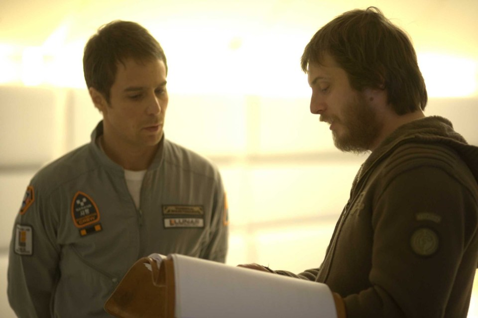 Duncan Jones and Sam Rockwell on the set of Moon