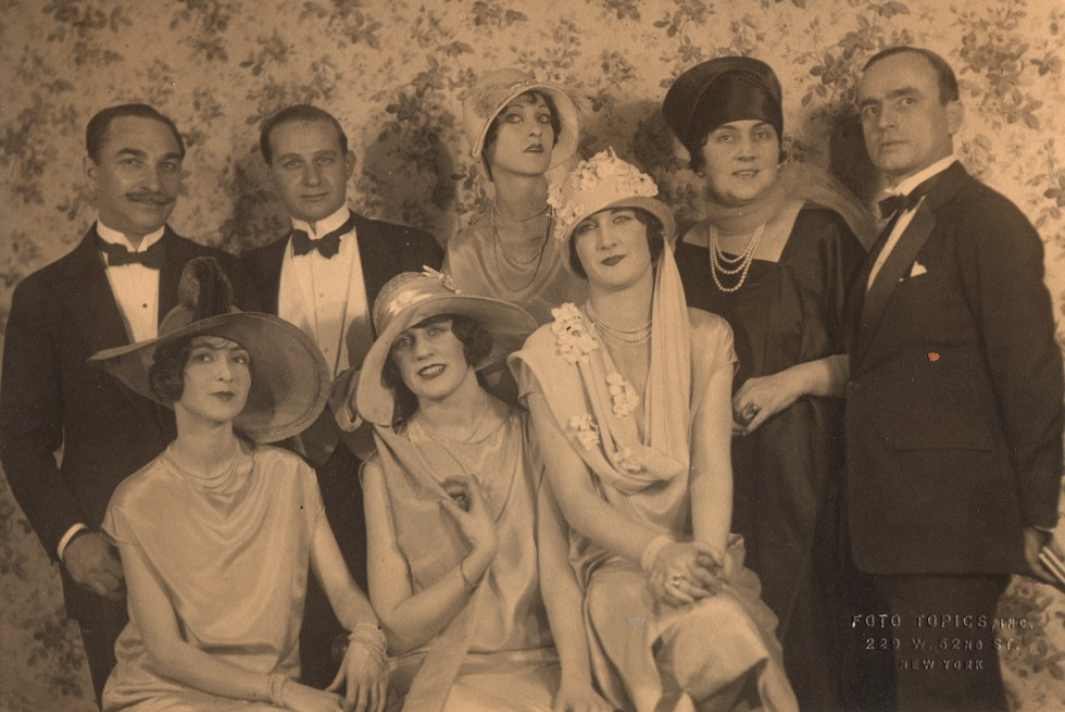 This theatrical group showcases the prize winners of the February 1925 Spring Millinery Show. My grandmother is the middle model in the front row. My great grandmother, Evelyn Lovejoy Ryan, is also in this photo, back row and second from the right.