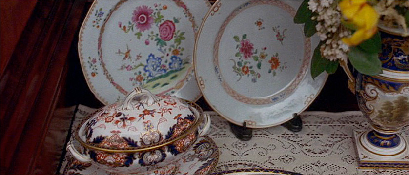 "(above) This and the next nine stills are of the dinner the van der Luydens gave for their cousin, the Duke of St. Austrey. (from the novel) ""The van der Luydens had done their best to emphasise the importance of the occasion. The du Lac Sèvres and the Trevenna George II plate were out; so was the van der Luyden ""Lowestoft"" (East India Company) and the Dagonet Crown Derby."""