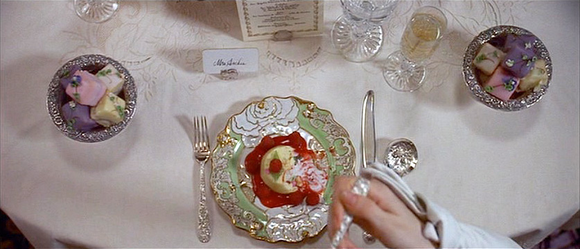 (above) This still and the following five are from Newland and May Archer's first formal dinner party as a married couple. Martin Scorsese chose not to show the entire meal, but instead we have skipped to the last course where the fanciful porcelain service we saw in the above photo is being used for dessert.