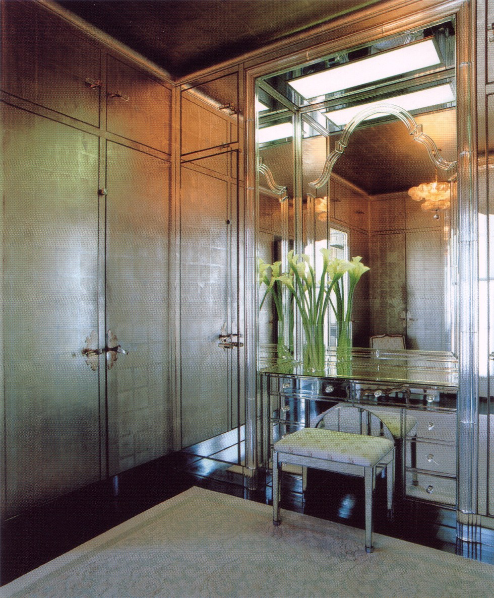 (above) This jaw-dropping-dressing room is from the Mr. and Mrs. James D. Zellerbach house. This room and the bathroom were bathed in tones ranging from sepia to silver. Here, in the dressing room, all the surfaces, except the floor, were mirrored or papered in matte silver, streamlining the many recessed doors opening into the built-in closets. Bolection molding in Steuben glass outlined the room's principal doorways, window, and mirrored niche containing the built-in dressing table and its Queen Anne-Venetian-style mirror.