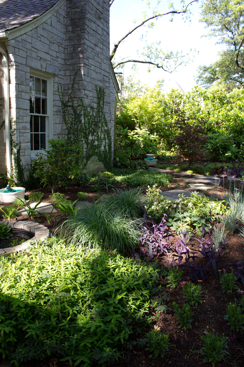 (above) There are stepping stone paths meandering through both beds.